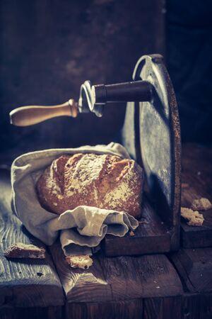 slicer: Slicing a tasty loaf of bread on the slicer Stock Photo