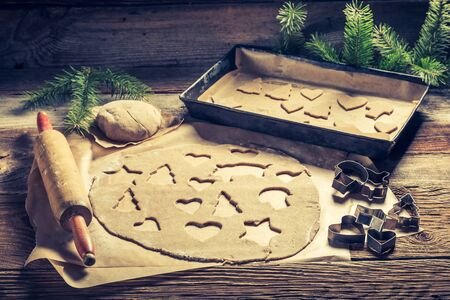 Making gingerbread cookies for Christmas on wooden table Stok Fotoğraf