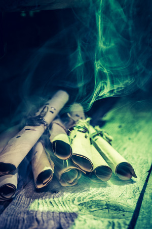 medieval medicine: Vintage witch workshop with green light and scrolls for Halloween Stock Photo