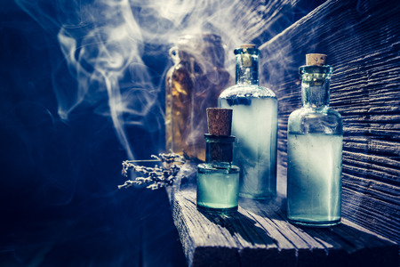 brebaje: Magical witch lab with blue light and potion for Halloween