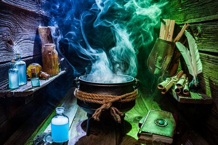 Vintage witch pot with blue and green smoke for Halloween Foto de archivo