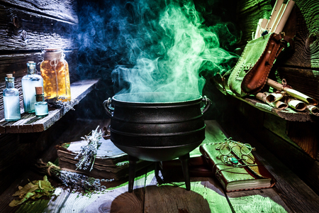 Witcher cauldron with blue potions and books for Halloween