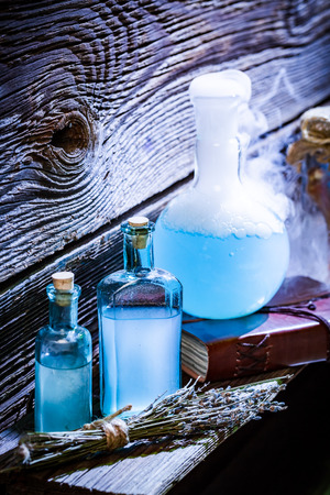 Magical potions with blue mixture in witch cottage for Halloween