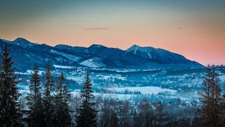 giewont: Illuminated peak by rays of sun in winter in Zakopane, Tatra Mountains, Poland