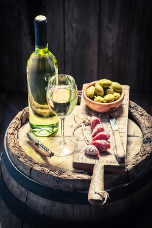 White wine with olives and cold cuts Stock Photo
