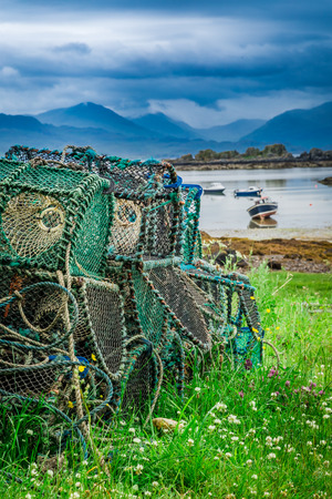 Colored cage for lobster on shore in Scotland