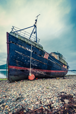 ship wreck: Rusty ship wreck in Fort William, Scotland