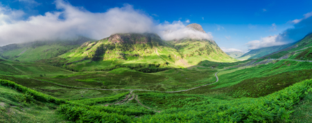 glencoe: Stunning panorama in the mountains of Glencoe at dawn, Scotland Stock Photo