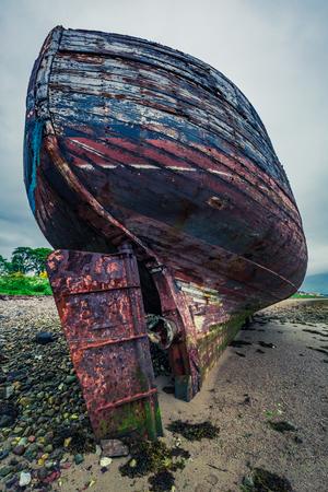 william: Rusty shipwreck on shore in Fort William, Scotland