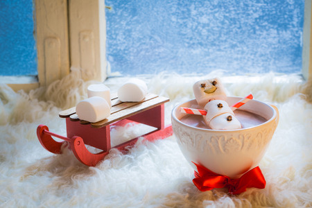 Sweet and happy snowman for Christmas in hot chocolate Stock Photo