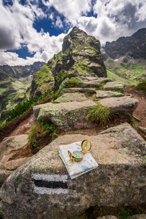 orientation: Orientation in mountains in summer with map and compass, Poland