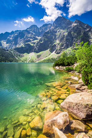 morskie: Beautiful pond in the mountains at sunrise in Poland Stock Photo