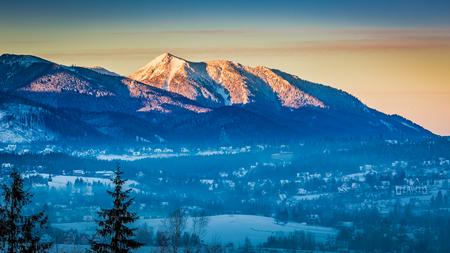 giewont: Sunrise in Zakopane with illuminated peak in winter, Tatra Mountains