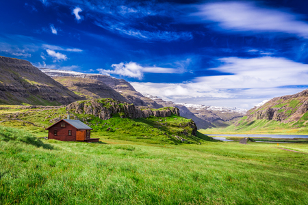 Small cottage in the mountains, Iceland in summer Editorial