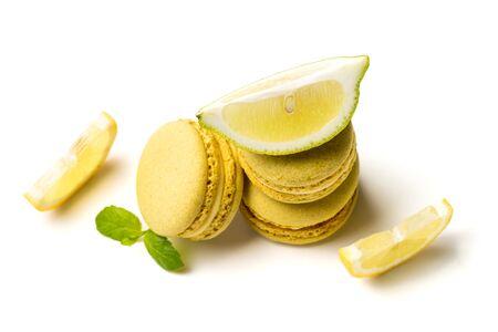 Closeup of tasty macaroons with lemon on white background Stock Photo