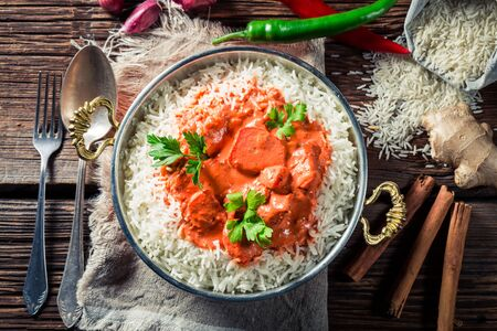 Spicy and sweet tikka masala with rice and sauce