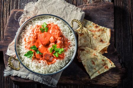 exotically: Tikka masala with rice, chicken and Naan bread Stock Photo