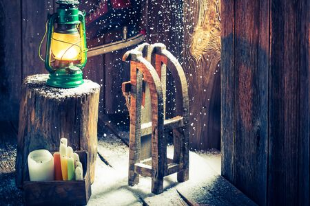 red oil lamp: Retro winter cottage with small wooden sleigh