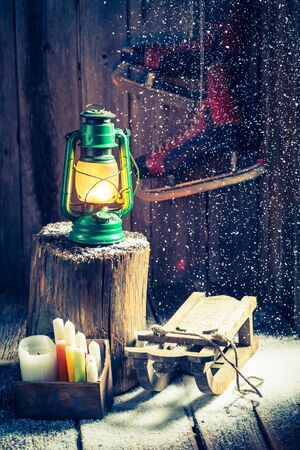 red oil lamp: Snowy winter hut with snow and oil lamp Stock Photo