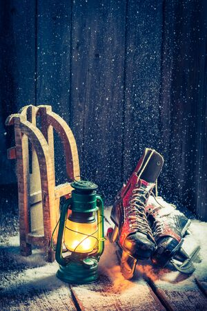 red oil lamp: Retro winter cottage with skates and wax Stock Photo