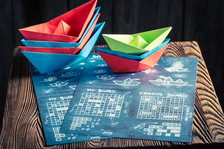 Childrens battleship paper game with red and blue ships