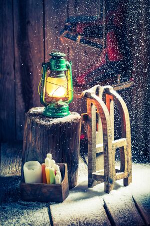 red oil lamp: Snowy winter cottage with skates and wax
