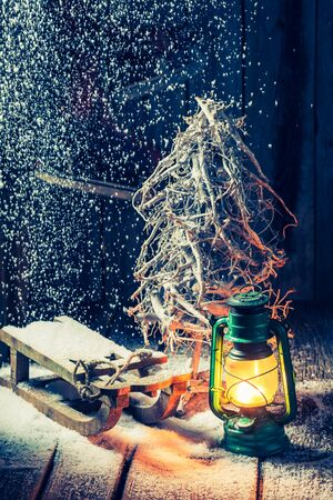 red oil lamp: Retro winter hut with small wooden sleigh