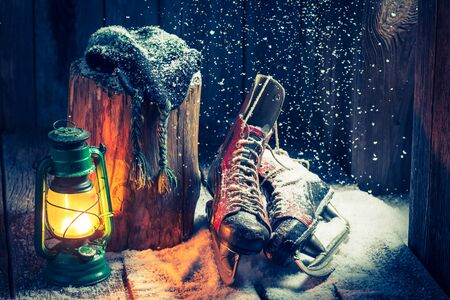 red oil lamp: Retro winter hut with skates and wax Stock Photo