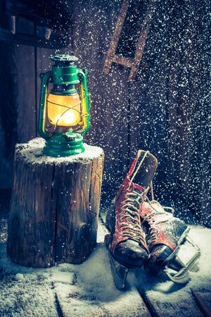 red oil lamp: Cozy winter hut with skates and wax