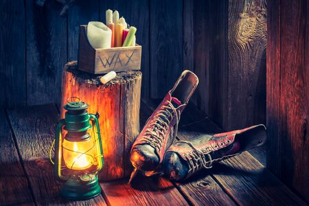 red oil lamp: Vintage winter hut with skates and wax