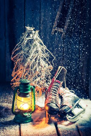 red oil lamp: Vintage winter hut with snow and oil lamp