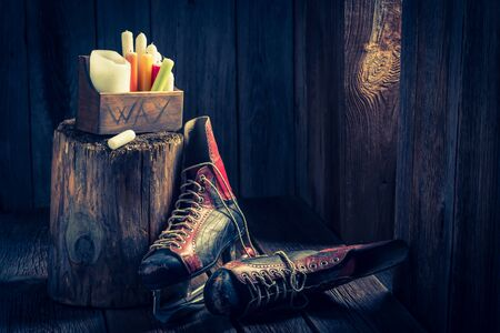 red oil lamp: Cozy winter cottage with skates and wax Stock Photo