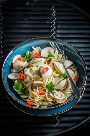Enjoy your seafood pasta made of clams, peppers and parsley