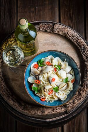 Delicious seafood pasta with clams, parsley and peppers