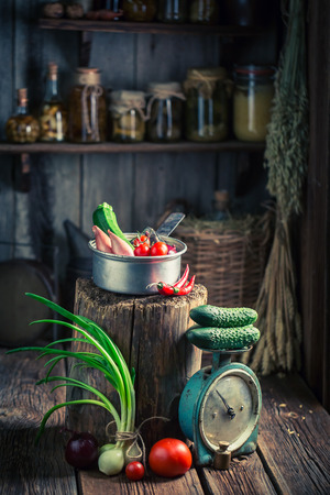 larder: Vintage wooden cellar with fresh herbs and vegetables