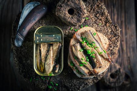 Healthy sandwich wirh sprats with on the wholegrain bread Stock Photo