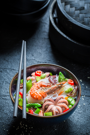 Hot seafood noodle with octopus and shrimps