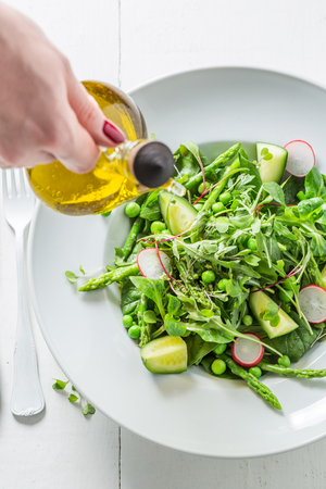 Healthy green salad with spinach, radishes and asparagus Stock Photo