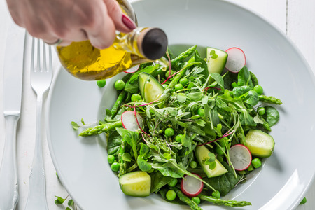 Homemade green salad with spinach, radishes and asparagus