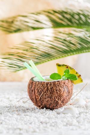 Tasty pinacolada in coconut in sunny day Stock Photo
