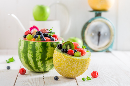 Tasty fruits salad in watermelon and melon in summer day Stock Photo