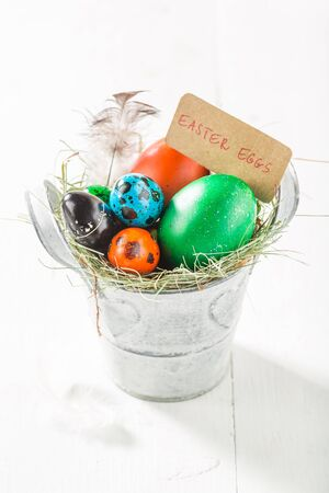 Closeup of Easter eggs in the bucket with hay Stock Photo