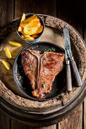 Tasty chips and tbone steak with salt and pepper Stock Photo