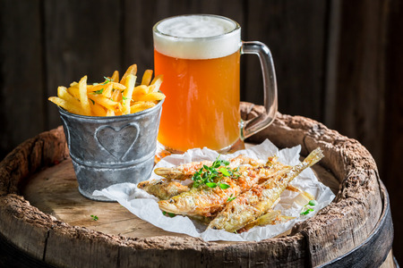 Tasty roasted smelt fish with cold beer