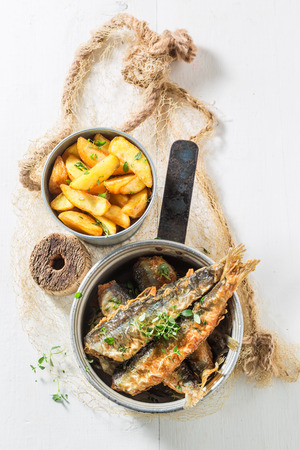Delicious roasted herring fish with salt and herbs Reklamní fotografie