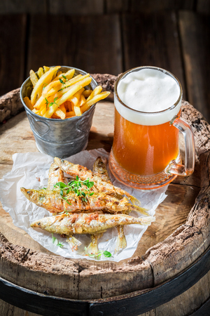 Tasty smelt fish and chips with cold beer Stock Photo