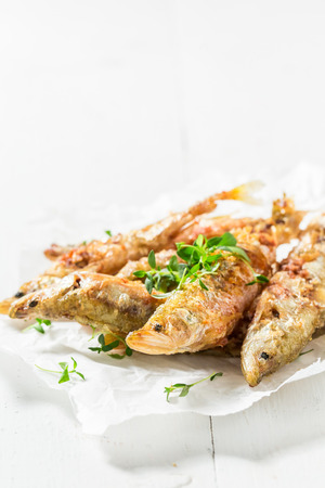 Tasty roasted smelt fish with salt and herbs Stock Photo