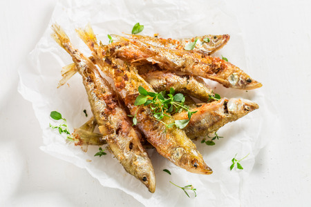 Delicious smelt fish and chips with salt and herbs