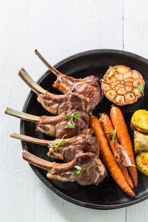 Delicious grilled ribs of lamb on an old white table Stock Photo