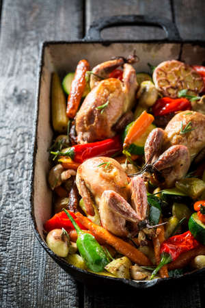 quail: Homemade quails with spices and vegetables in casserole